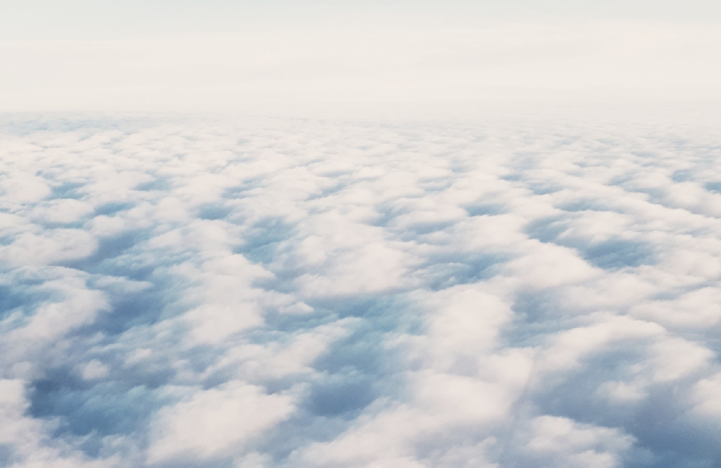 Airplane contemplative view clouds thoughts